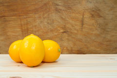 Bright yellow juicy lemons on  table. Royalty Free Stock Image