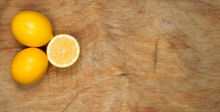 Bright yellow juicy lemons on table. royalty free stock photography