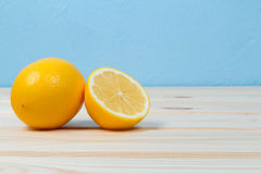 Bright yellow juicy lemons on table. royalty free stock images