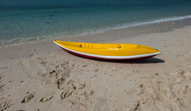 Bright yellow kayak on the beach Royalty Free Stock Photography