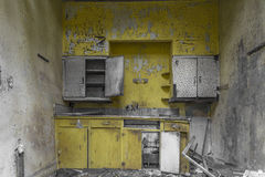 Bright yellow kitchen in an abandoned house Stock Photo
