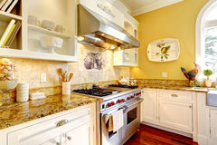 Bright yellow kitchen room with granite tops Stock Photo
