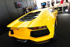 Bright yellow Lamborghini Aventador on display at the Singapore Yacht Show 2013 Royalty Free Stock Photography