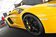 Bright yellow Lamborghini Aventador on display at the Singapore Yacht Show 2013 Stock Photography