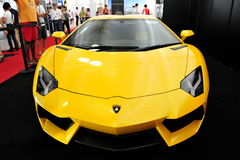 Bright yellow Lamborghini Aventador on display at the Singapore Yacht Show 2013 Stock Photo