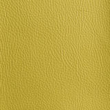 BRIGHT YELLOW LEATHER TEXTURED BACKGROUND Royalty Free Stock Photography