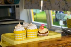 Bright yellow meringue cupcakes at display on counter top Stock Images