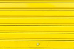 Bright yellow metal sliding door with key hole Royalty Free Stock Photos