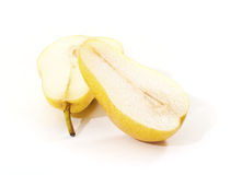 Bright yellow pear cut in half Stock Images