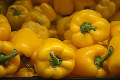 Bright Yellow Peppers Royalty Free Stock Photography