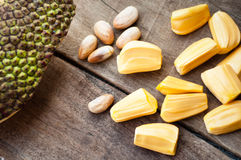 Bright yellow pieses of jackfruit on wooden background Royalty Free Stock Photos