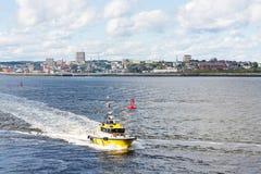 Bright Yellow Pilot Boat Speeding From St Johns Royalty Free Stock Photos