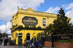 Bright yellow pub. Brighton, United Kingdom - March 28 2018: The Bright yellow painted pub The Gladstone on the Lewes Road stock photography