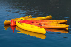 Bright yellow and red canoes Royalty Free Stock Image