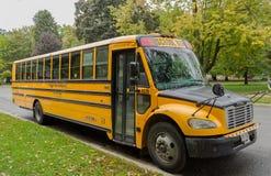 Bright yellow school bus Stock Image