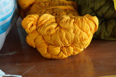 Bright yellow skeins of silk Stock Image