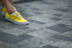 Bright yellow sneakers stock photos