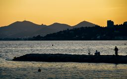 Bright yellow sunset on beach with sunset in Juan les Pins, Cote d`Azur, France.  stock photo