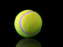 Bright yellow tennis ball Royalty Free Stock Photo