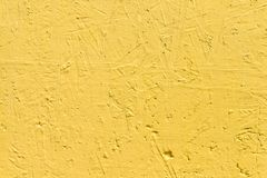 Free Bright Yellow Textured Background. Cement Surface With Cracks And Scratches Painted With Yellow Paint. Stock Photography - 167455512
