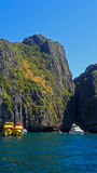 Bright Yellow Tour Boats in Iconic Thai Islands Stock Photo