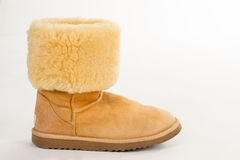 Bright yellow winter boot on a white background. Royalty Free Stock Photos