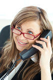 Bright young businesswoman phoning wearing glasses Stock Images