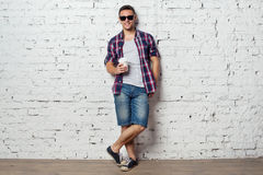 Bright young man hipster on vacation enjoying the Royalty Free Stock Photography