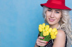 Bright Young Woman with a Bouquet of Flowers. Spring Concept Royalty Free Stock Images