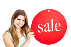 Bright young woman holding a red panel Stock Photos