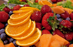 Bright Yummy Mixed Fruit Plate. A tray of bright tasty mixed fruits at a catered event Royalty Free Stock Photos