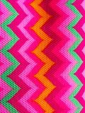 Bright zigzag on fabric pattern stock photos