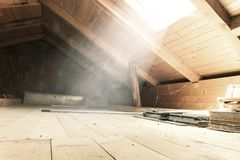 Empty brighten attic with light rays at window. Brighten attic with light rays at window stock photo