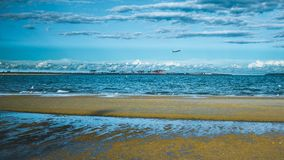 Plane over Sydney-Above Brighten le sands Beach royalty free stock image