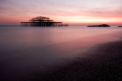 Brighton old pier. Dusk at Brighton old pier in England stock image