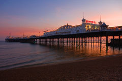 Brighton pier. Dusk at Brighton pier in England royalty free stock images