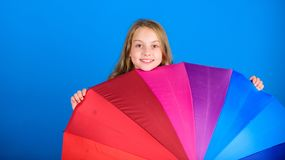 Brighten up life. Kid peek out colorful rainbow umbrella. Color your life. Girl cheerful hide behind umbrella. Colorful royalty free stock photos