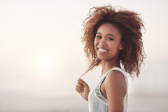 Brightening up sunset with her smile Royalty Free Stock Photography