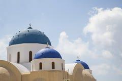 Brightly blue coloured greek chapels on Santorin stock image