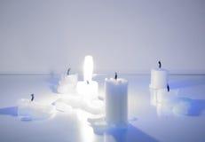 Brightly burning candle Stock Image