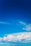 Brightly cloudy sky with copyspace Stock Images