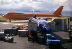 Brightly colored airplanes on tarmac. Dallas Airport,Texas stock photography