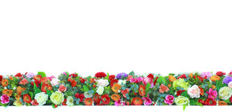 Brightly colored artificial flowers Royalty Free Stock Image