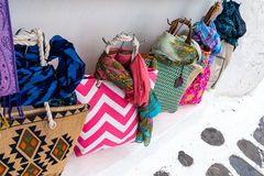 Brightly colored bags shopping in Mykonos Royalty Free Stock Photo