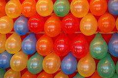 Brightly Colored Balloons. Rows of brightly colored balloons in a midway game at a county fair stock photography