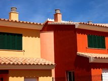 Brightly colored beach homes royalty free stock photography