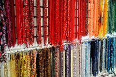 Brightly colored beads. Hanging in a shop create a rainbow of colors for a backdrop that rivals an artist's palate Stock Images