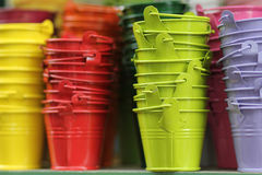 Brightly colored buckets at the flower market in Paris Stock Photography