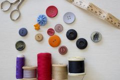 Brightly colored buttons and sewing cotton Royalty Free Stock Photography