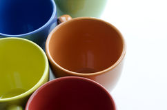 Brightly colored ceramic cups Royalty Free Stock Photos